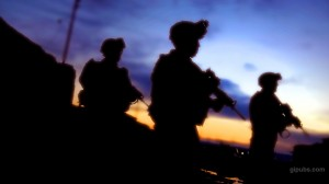 Army Desktop Wallpaper of Soldiers on Patrol with a Magnificent Purple Sunset